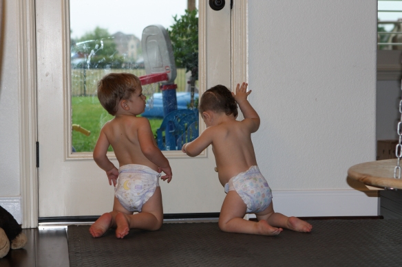 Play time after a bath with twin brother.  Austin and Savanna.