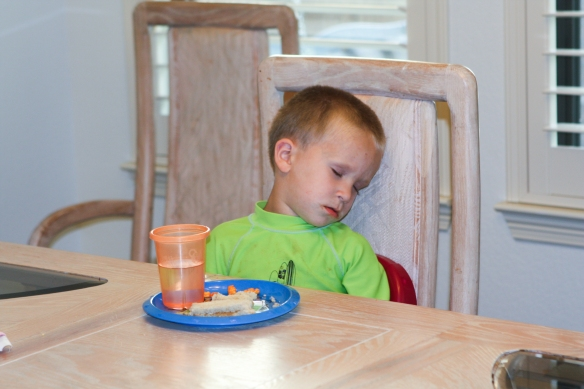 Pre-school and then playing at the splash pad all afternoon is tiring.  This is 6:15 at night, and Brandon falls asleep at the table.