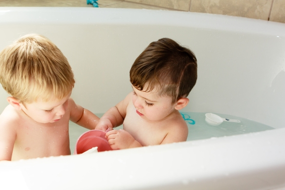 In the tub fun, without the big kids.  A rare moment worthy of a photograph for memory.