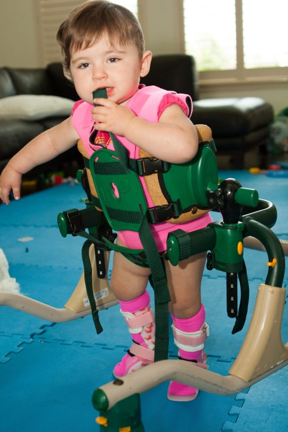 Savanna decked out with a compression vest, AFO's, and a medical walker.